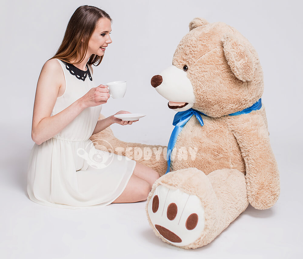 Girl spend time with friend giant teddy bear