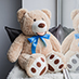 Giant teddy bear near window - TeddyWay